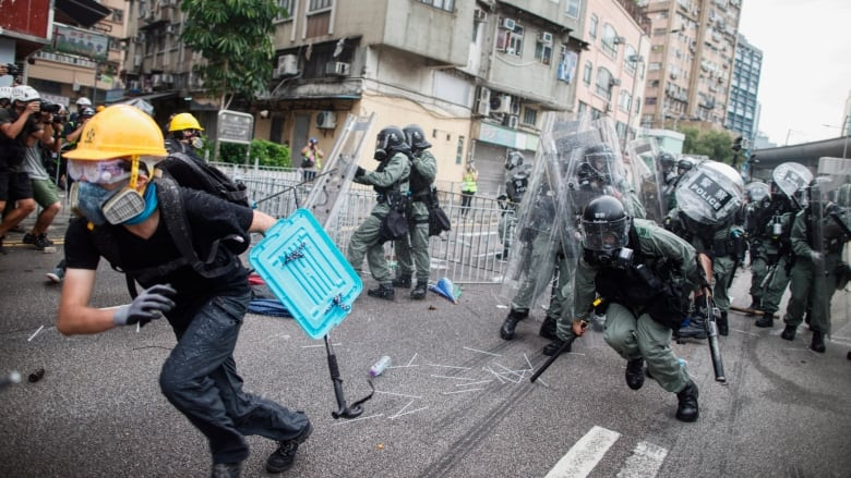 Hong Kong protesters appear in court on riot charges