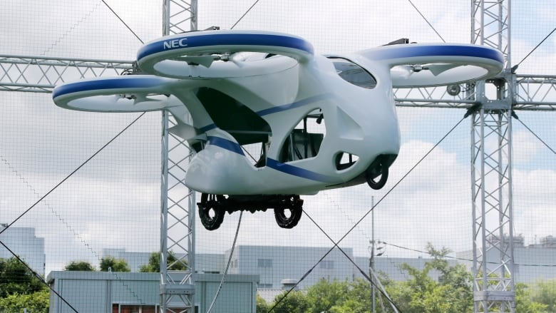 Japan S Nec Shows Off A Flying Car That Can Hover Steadily For A Minute Cbc News