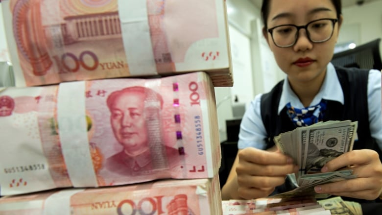 Trade war rhetoric between U.S. and China eases Tuesday as Beijing revalues yuan