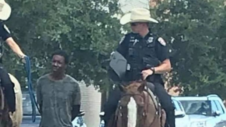 Texas police chief apologizes after mounted officers lead man by rope