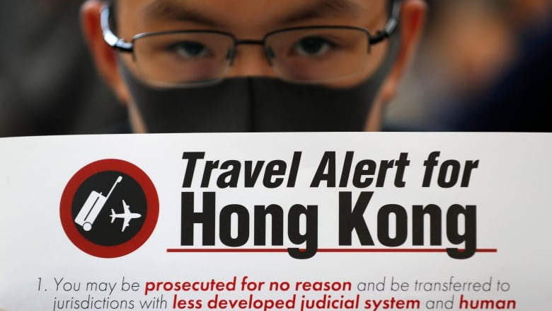Hong Kong protesters crowd airport as city recalls police commander