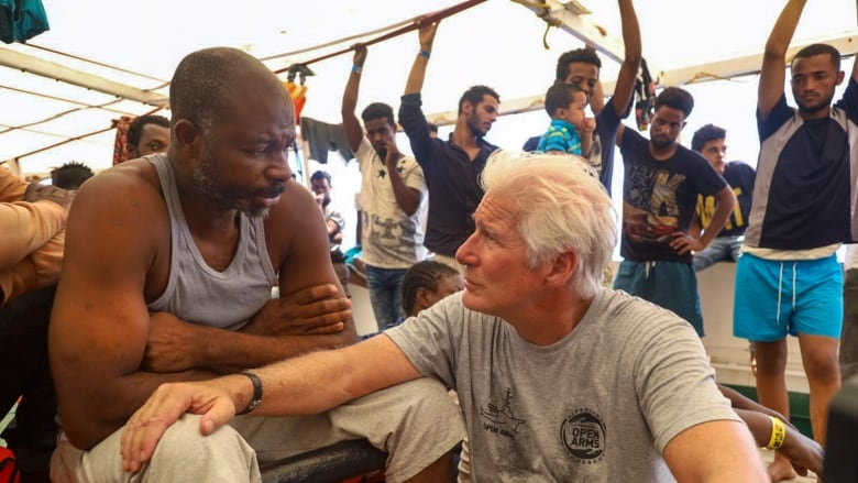 Richard Gere visits migrants stuck at sea in the Mediterranean | CBC
