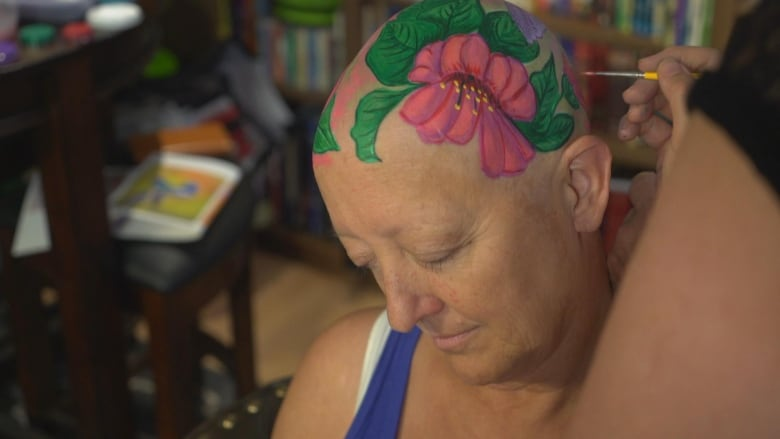 How a cancer patient is using whimsical art — and lots of paint — to cope with chemotherapy