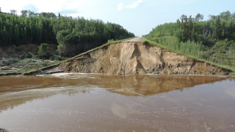 Washed away Northern Sask. highway causes cancellations for resort