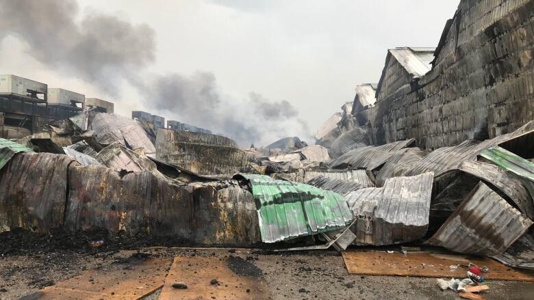 Firefighters still battling smoke, hot spots at St. Catharines flower farm