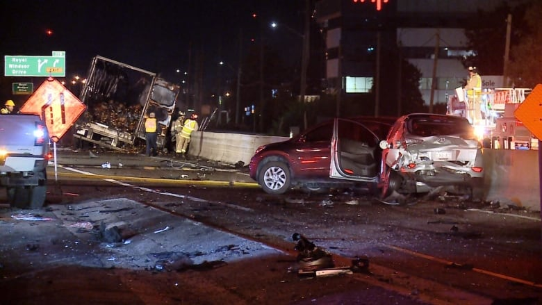 Transport truck driver charged in 8-vehicle QEW crash that killed woman