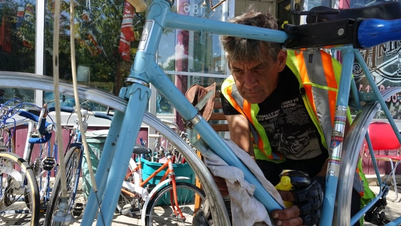 This Greenfield Park shop doesn't only save old bikes — it's a 'haven' in the community