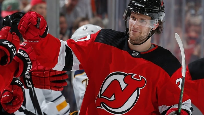 pretty nice 46a6b f969b Another RFA domino falls with Devils re-signing forward ...
