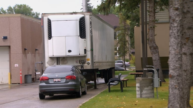 Bodies stored in rented trailer as medical examiner copes