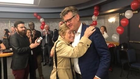 Dougald Lamont hugs supporter