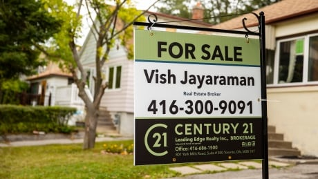 "House ""For Sale"" signs in Toronto real estate."