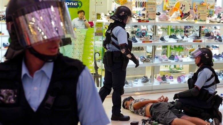 Skirmishes break out in Hong Kong mall amid opposing rallies