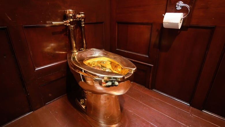 Maurizio Cattelan's golden toilet stolen from British art exhibit