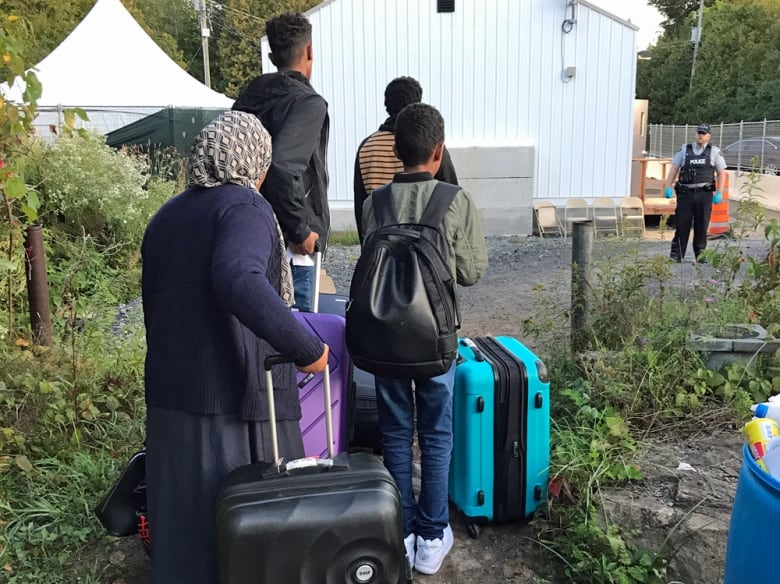 How thousands of asylum seekers have turned Roxham Road into a de facto border crossing