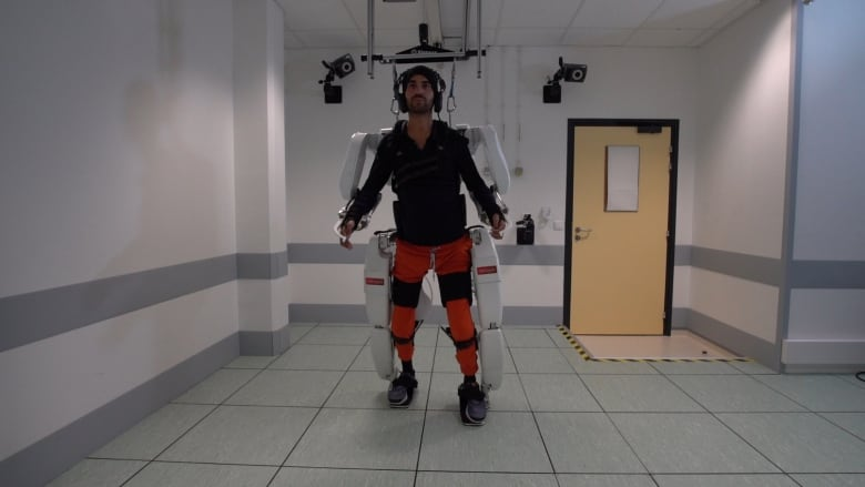 Paralyzed man walks using brain-controlled exoskeleton