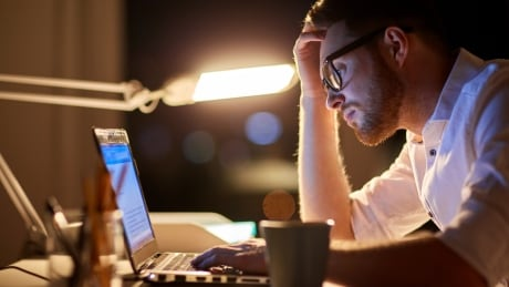man working on computer late entrepreneur business office work
