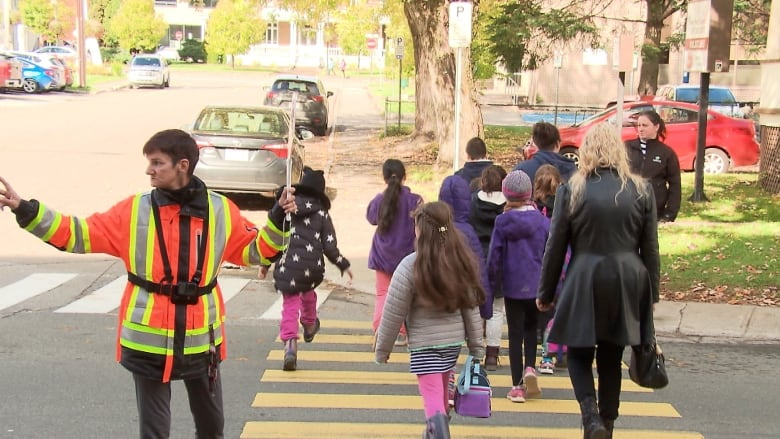 Body cams for crossing guards? In a small Quebec town it slows drivers down