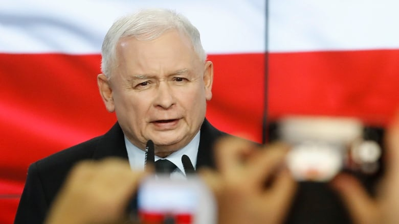 Poland's governing conservatives claim election win