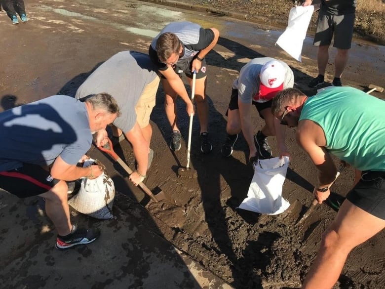 Canada's Rugby World Cup team helps clean up flood damage caused by Typhoon Hagibis