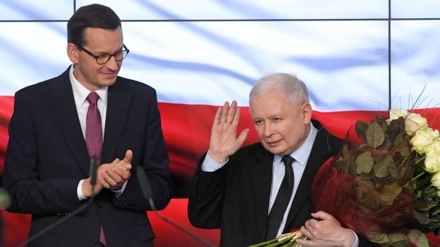 Poland's governing conservatives win narrow majority in parliament