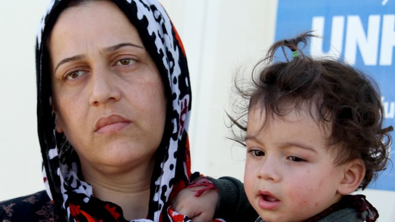 Syrian Kurds paying smugglers to find their way to refuge in northern Iraq