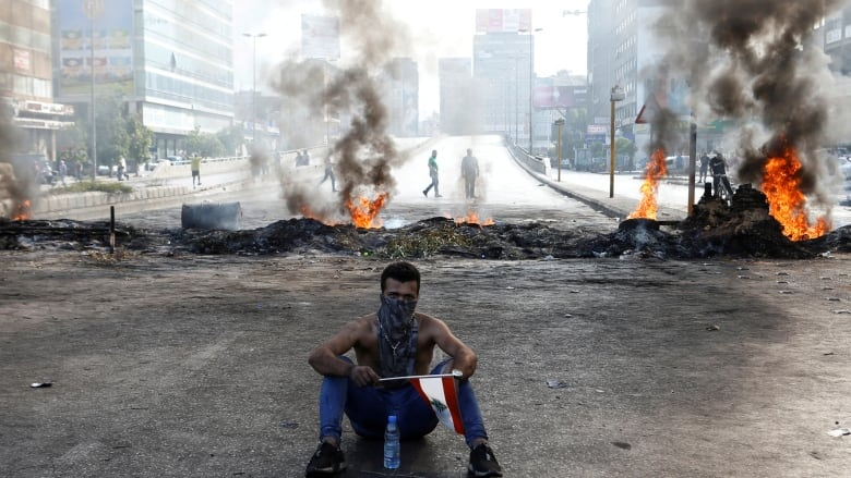 Protests sweep Lebanon as fury at ruling elite grows