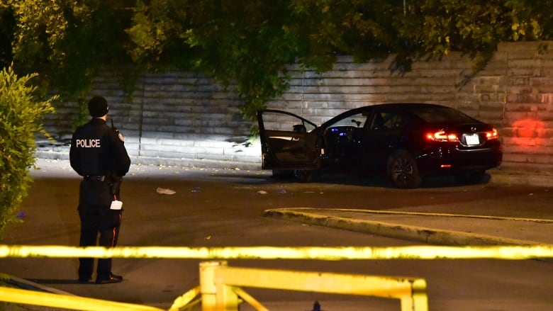 Police canvass TCH complex after fatal shooting of man in parked car