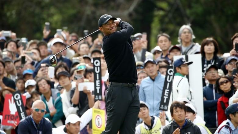 Tiger Woods starts slow, birdies way to 64 in Japan