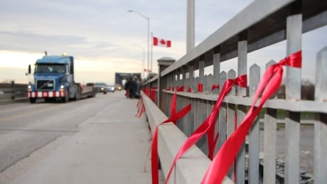 Red ribbons on Lockport bridge
