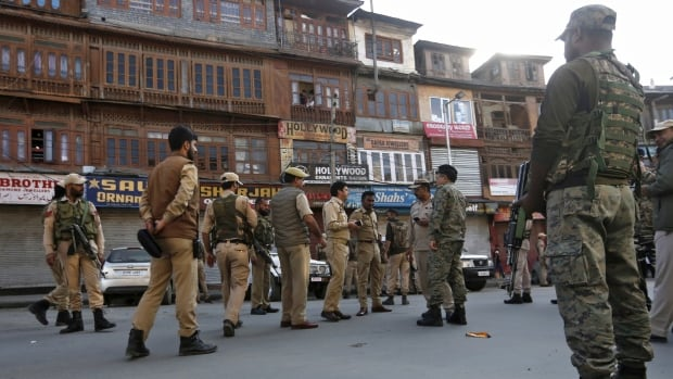 <b>India moves to divide contested Jammu and Kashmir state despite protests, attacks</b>