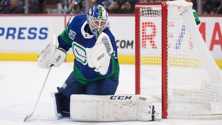 Canucks rally but fall to Cup-champion Blues in overtime