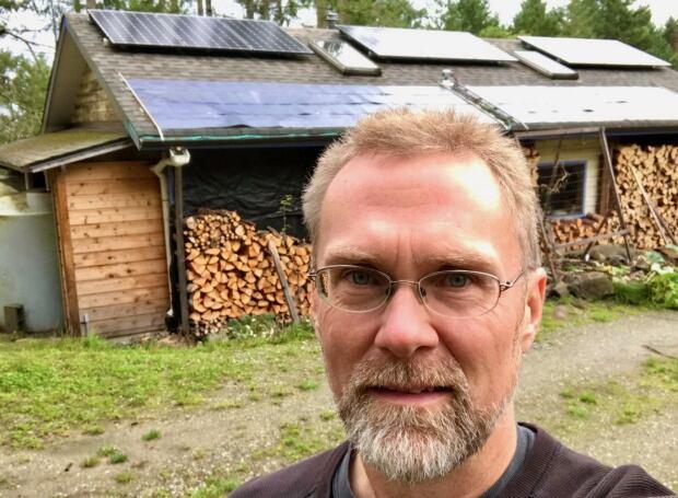 David Elderton with solar panels