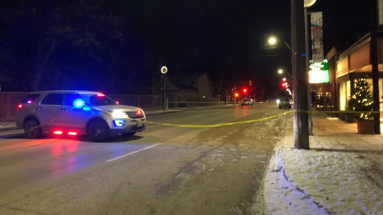 Police block off traffic on Academy Road while investigating incident