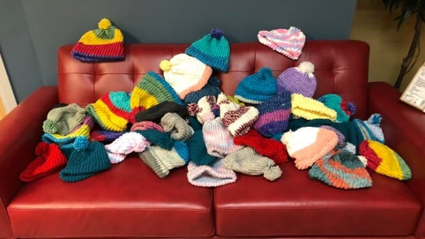 Whitehorse woman knits 50 colourful toques for CBC Yukon's sock drive - CBC.ca