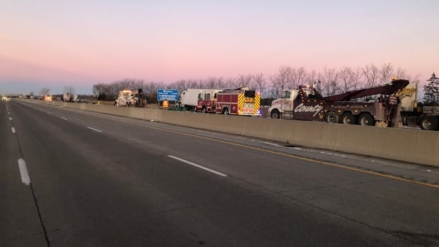 2 transport trucks collide on Highway 401 in Tecumseh, westbound lanes closed - CBC.ca