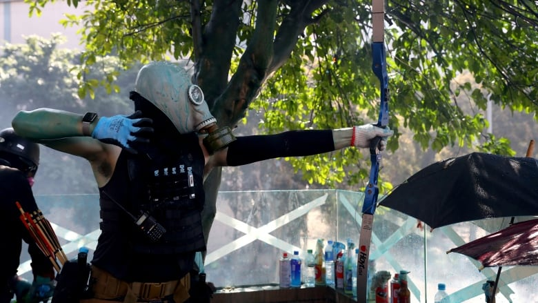 Hong Kong protesters fire arrows from campus fortress