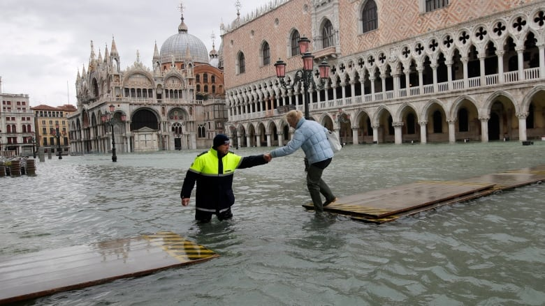 Flooded Venice records 3rd exceptional tide as other parts of Italy hit with rain, snow