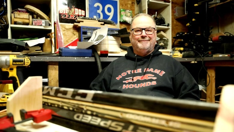 Love of hockey inspired Sask. man to turn old sticks into furniture, art