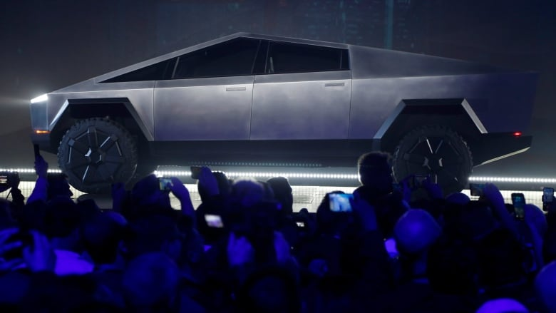 Tesla launches new electric truck, taking aim at lucrative pickup market