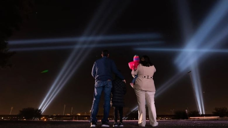 A Canadian artist's light installation lets people talk across the Mexico-U.S. border