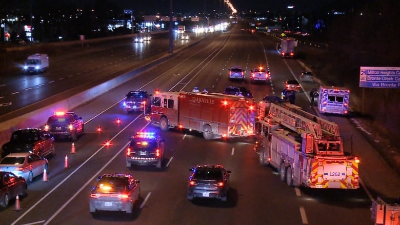 Woman, 34, dies after being struck by transport truck on QEW