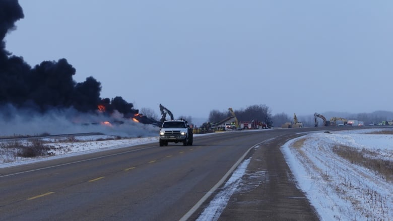 'I still see flames' says local resident more than 24 hours after CP train derailed in Sask.