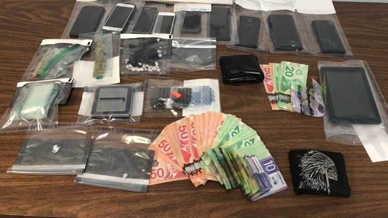Northern Manitoba drug bust nets 8 arrests, cocaine and cash, RCMP say