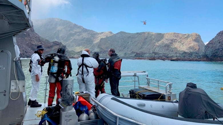 New Zealand divers search contaminated waters for remaining volcano victims