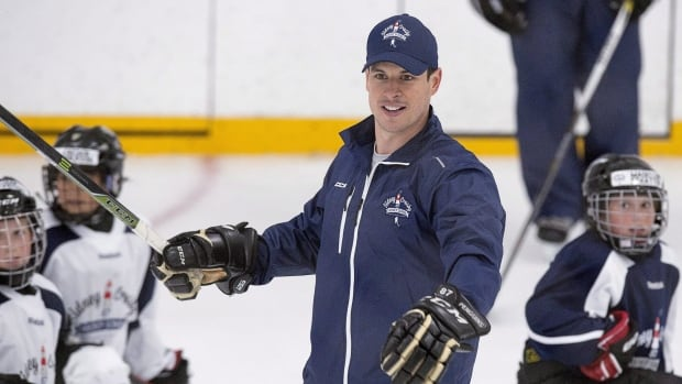 Player #87, Sidney Crosby, gives 87 sets of new hockey gear to young N.S. players | CBC News