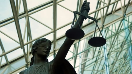 Statue at B.C. Supreme Court holding scales of justice
