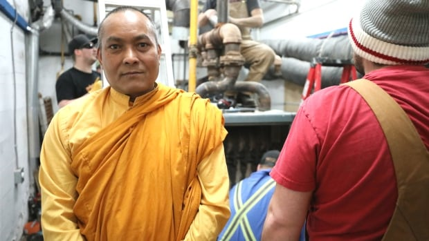 Volunteers help Buddhist Centre of Regina prepare for new boiler