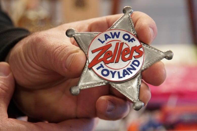 law of zellers toyland button - As final Zellers stores close, former employees swap memories, memorabilia