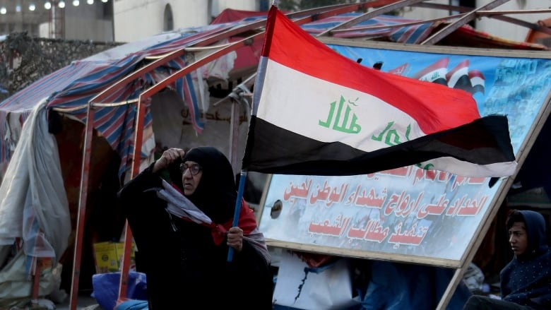 Officials, activists say 2 Iraqi protesters killed amid renewed violence in Baghdad