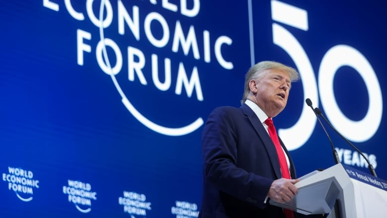 Trump lauds U.S. economy at Davos as trial set to begin in Washington